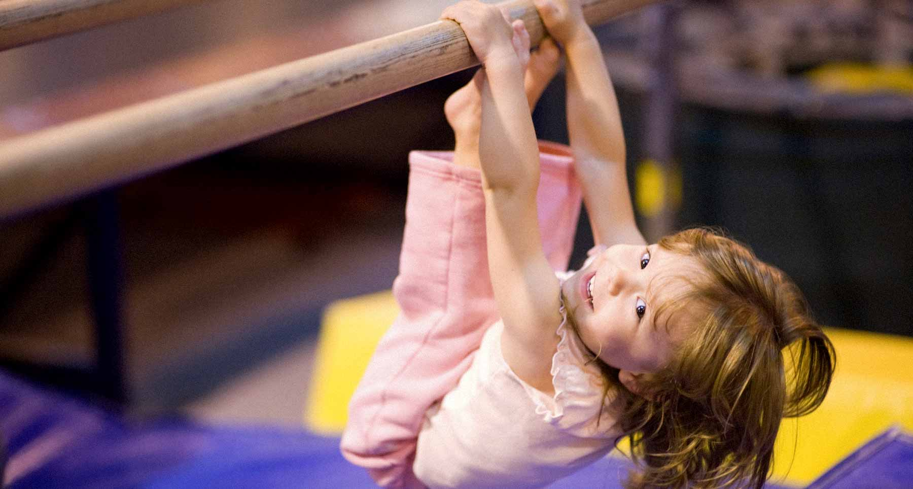 small gymnast on bars